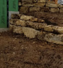 Timber home retaining wall