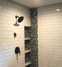 custom shower with subway tile and gray inset
