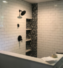custom tile shower with gray inset