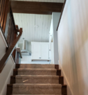 wood stair case with carpet runner installed