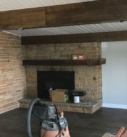 fireplace with beams