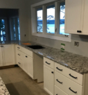 white cabinets with granite counters
