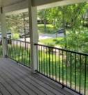 porch with metal railing