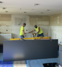 carpenters installing cabinetry