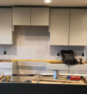 painted white cabinets with gray island