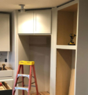 white painted cabinets  and space for refigerator