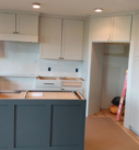 white cabinets with gray island and handles added