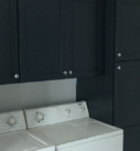 black painted cabinetry with washer and dryer