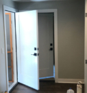 hallway with wood floors and white doors and trim