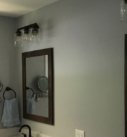 lighting and mirrors installed in bathroom