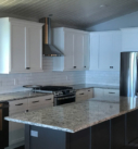 finished kitchen- white cabinets, granite and stainless steel