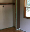 demolition of existing woodwork around closet and windows