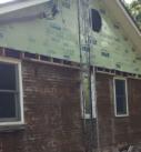 exterior demo of brick and siding