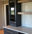 built in gray cabinets in dining space
