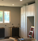 dark stained cabinetry and white