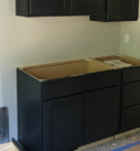 dark stained cabinetry in laundry room