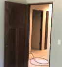 installation of dark stained 3 panel doors