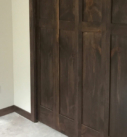 dark wood paneled closets with base and case