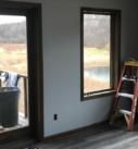 dark wood trim around windows and doors