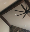 dark ceiling beams and ceiling fan